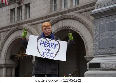 Washington/USA – January 19, 2019: A Trump look-alike demonstrator at the Trump Hotel on Pennsylvania Avenue at the 2019 Women's March.