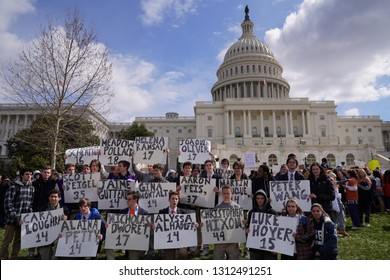 """Washington/USA – March 24, 2018: """"March for Our Lives"""" protesters holding signs with the names of those killed at Marjory Stoneman Douglas High School in Parkland, Florida."""