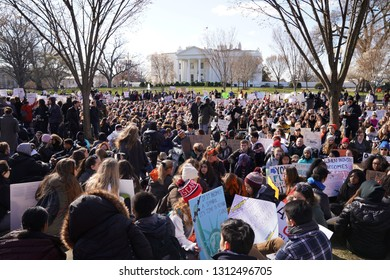 """Washington/USA – March 24, 2018: """"March for Our Lives"""" protesters observing 17 minutes of silence in honor of all those killed at Marjory Stoneman Douglas High School in Parkland, Florida."""