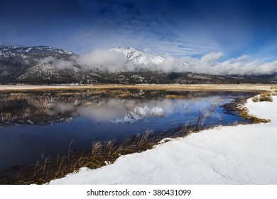 Washoe Valley, Nevada.  Pond reflection and slide mountain in winter with snow.