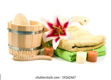washtub with candles and flower isolated on a white background