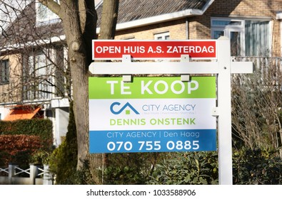 Wassenaar, The Netherlands - February 25, 2018: A realtor sign with the text For Sale and this saturday open house in dutch