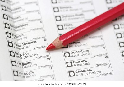 Wassenaar, The Netherlands - March 19, 2014: A list of candidates and a red pencil for municipal elections in the Netherlands