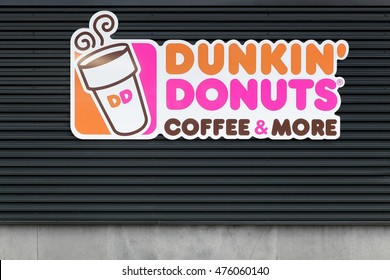 Wasserbillig, Luxembourg - July 24, 2016: Dunkin' Donuts sign on a wall. Dunkin' Donuts is an American global doughnut company and coffeehouse chain