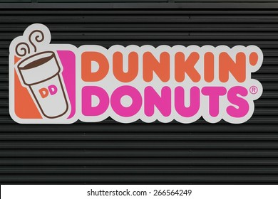 Wasserbillig, Luxembourg- March 24, 2015: Dunkin' Donuts sign on a wall. Dunkin' Donuts is an American global doughnut company and coffeehouse chain