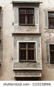 Wasserburg, Germany - detail of ancient facade of a building dated 1555 in the medieval old town, with painted decorations around the jutted windows