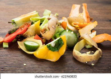 Waste Based Cooking. Elevated View Of Vegetable And Fruit Peelings On Wooden Table