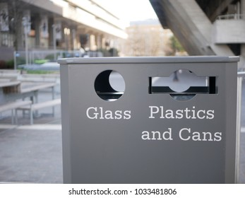Waste bin for recycling glass and plastics and cans separately on the south bank of the Thames in London UK