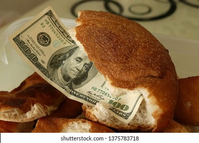 waste of bread and 100 usa banknotes, stale bread and material damage, hungry people and bread wastage,