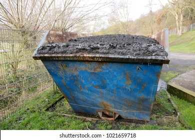 Waste container filled with sewage sludge