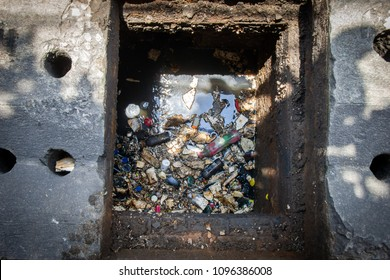 Waste garbage and grease in the drain. That is why the drain pipe is clog up. Part of the flood problem.
