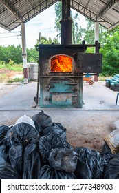 Waste incineration plant is working to burn garbage by worker.