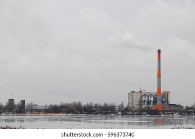 Waste incinerator plant with smoking smokestack. The problem of environmental pollution by factories