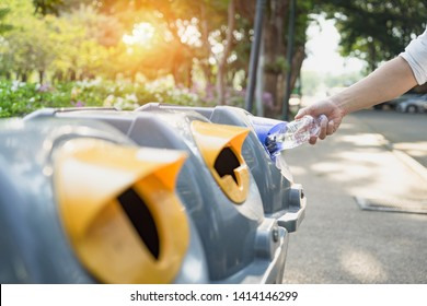 Waste management, Man throwing plastic bottle into recycle bin. Waste separation rubbish before drop to garbage bin to save the world, environment care. Pollution trash recycling management concept.