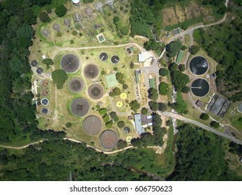 Waste management water treatment facility from birds eye view industrial complex