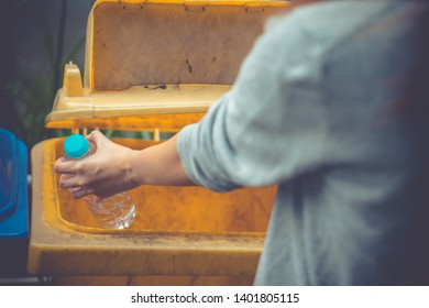 Waste management, Woman throwing plastic bottle into recycle bin. Waste separation rubbish before drop to garbage bin to save the world, environment care. Pollution trash recycling management concept.