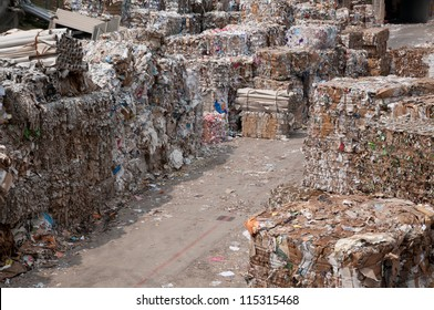 Waste paper recycling. This paper mill is a factory devoted to making paper and cardboard from recycled paper  using a Fourdrinier Machine.