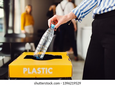Waste separation and recycling in business office, a midsection.