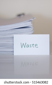 Waste; Stack of Documents on white desk and Background.