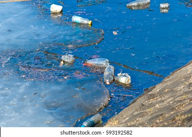 Waste, trash and garbage floated on a polluted river