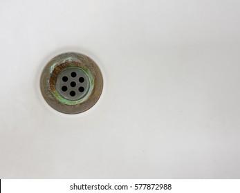 Waste water hole on white ceramic sink.