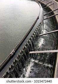 Waste water treatment sewage flowing through large tanks