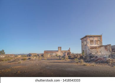 Wasteland of an abandoned place with some ruined buildings of an old factory