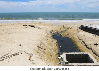 Wastewater or sewage discharge on the beach.Wastewater released by hotels and buildings in Thailand.Environmental pollution.Wastewater, ecological problem