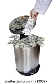 Wasting money - dollar bills in trashcan