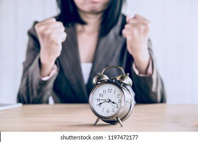 wasting time concept with angry Asian HR woman bored waiting someone late for job interview