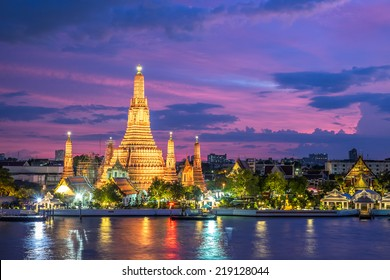 Wat Arun along Chao Phraya River during sunset in Bangkok, Thailand