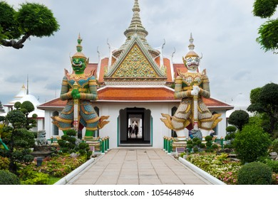 Wat Arun, Bangkok - photo of one the temple's gates with the gigantic guardians protecting it