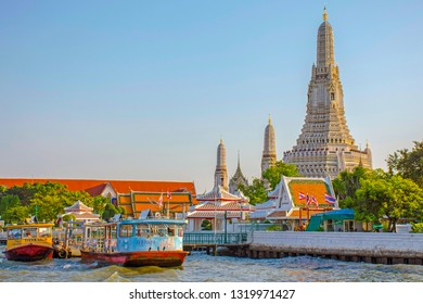 Wat Arun, Bangkok Thailand - March 2018:The most outstanding spot is the central  prang, the pagoda in corn-cob shape