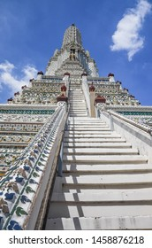 Wat Arun with blue sky, the temple of Dawn.Wat Arun is a Buddhist temple in Bangkok.Wat Arun is among the best known of Thailand's landmark.