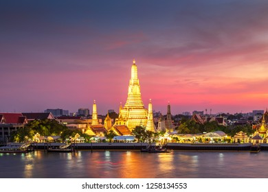 Wat Arun Buddhist Temple at sunset in bangkok Thailand. Wat Arun is among the best known of Thailand's landmarks. Temple Chao Phraya Riverside. The tourist like to take pictures and admire the beauty.
