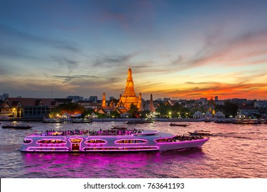 Wat Arun and cruise ship in twilight time, Bangkok city, Thailand