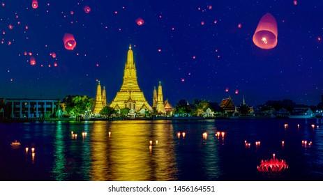 Wat arun in night time and floating lamp in yee peng festival under loy krathong day, Bangkok city, Thailand
