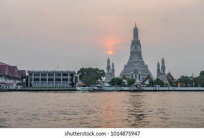 Wat Arun Ratchawararam Ratchawaramahawihan Temple at sunset in Bangkok, Thailand.
