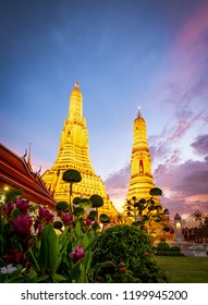 Wat Arun Ratchawararam at sunset with beautiful dark blue sky and clouds. Wat Arun buddhist temple is the landmark in Bangkok, Thailand. Attraction art and ancient architecture in Bangkok, Thailand.
