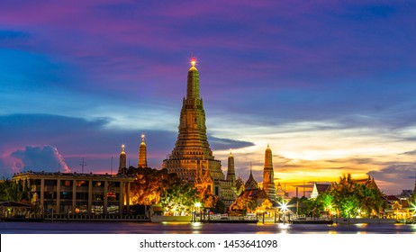 Wat Arun Ratchawararam at twilight, a Buddhist temple in Bangkok, Thailand.