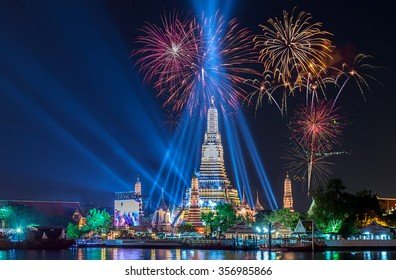 Wat Arun  river side with Beautiful Fireworks for celebration at twilight time in Bangkok, Thailand