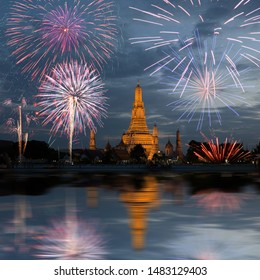 Wat Arun temple in bangkok with fireworks. New year and holiday concept.