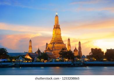 Wat Arun the Temple of Dawn during sun set on Chaophraya River Bangkok Thailand,the new landmark.