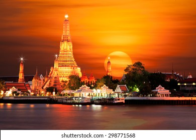 Wat Arun the Temple of Dawn during sun set on Chaophraya River Bangkok Thailand.