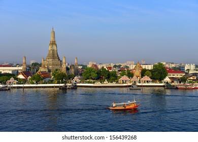 Wat Arun or temple of dawn on the back of Chao phaya river , Bangkok Thailand