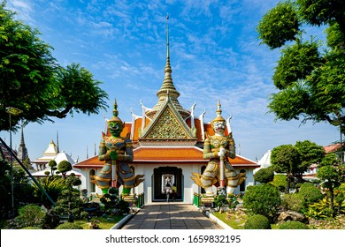Wat Arun or temple of the dawn. Two giant guardians, Thotsakan & Sahatsadecha stand either side of the entrance gate.