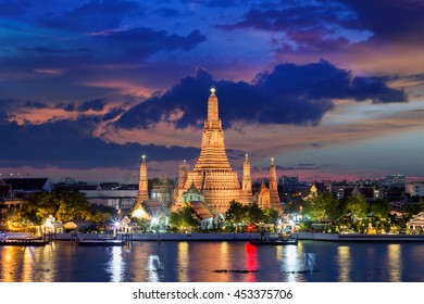 Wat Arun Temple at sunset in bangkok Thailand .