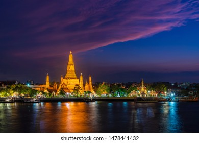 Wat Arun Temple at sunset in twilight. A buddhist temple in Bangkok Yai district of Bangkok, on the Thonburi west bank of the Chao Phraya River, Landmark of Thailand.