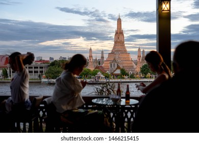 Wat Arun, THAILAND - July 29, 2019: Unidentified Enjoy eating at the restaurant beside Wat Arun Rung or Wat Arun is a beautiful backdrop.