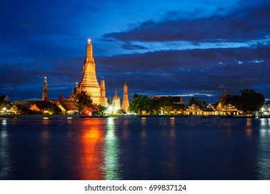 WAT ARUN with water reflection at twilight time , BANGKOK THAILAND